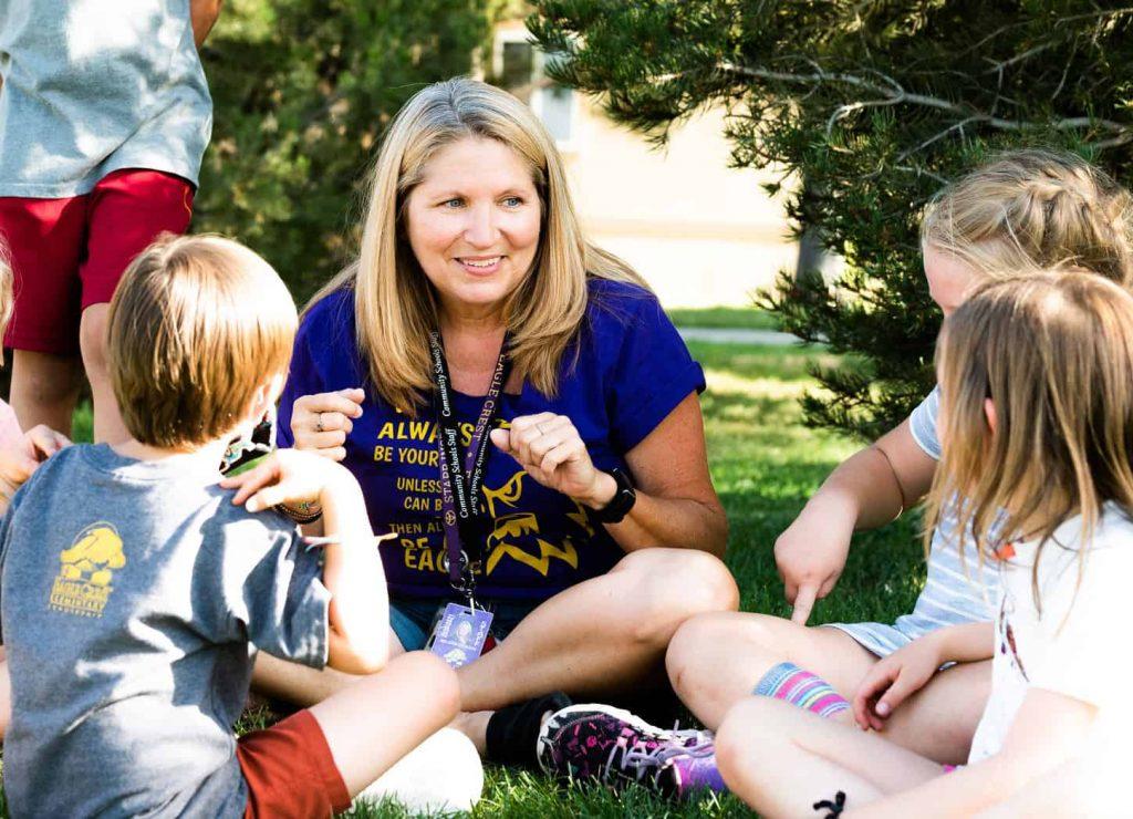 Melodie Erdmann working outside with Community Schools children